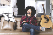 Afro Man Composing Song At Home