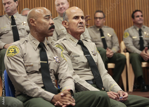 Los Angeles County Sheriff Lee Baca sits next to Assistant