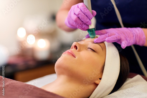 woman having microdermabrasion facial treatment Canvas Print