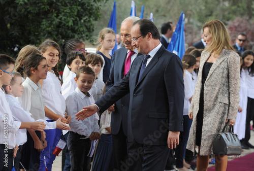 French President Hollande, his companion Trierweiler walk