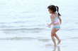 Happy time of little girl playing on the beach