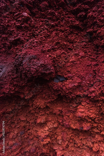 Fotobehang Bordeaux Volcanic porous red rocks in Iceland, texture