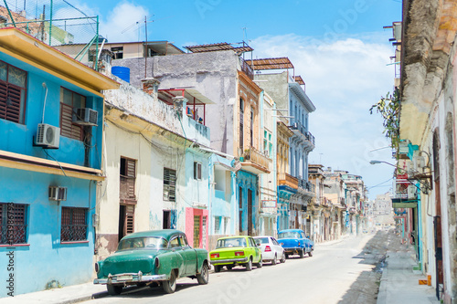 Poster Havana HAVANA, CUBA - APRIL 14, 2017: Authentic view of a street of Old Havana with old buildings and cars