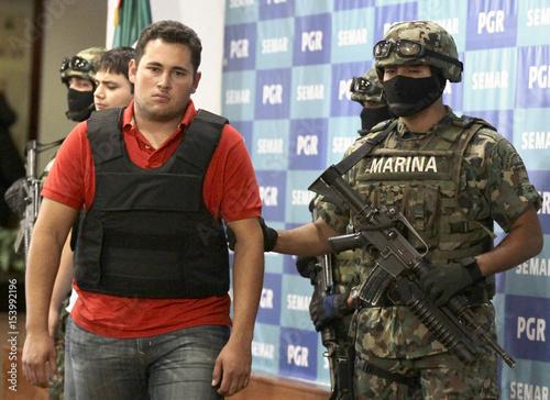 mexican marines escort jesus alfredo guzman as he is presented to