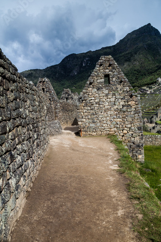 Photo  Preserved houses at Machu Picchu ruins, Peru