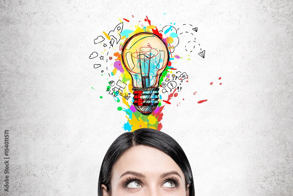 Fototapeta Woman with black hair and colorful light bulb