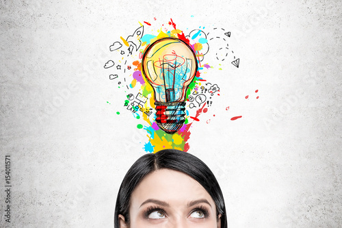 Obraz Woman with black hair and colorful light bulb - fototapety do salonu