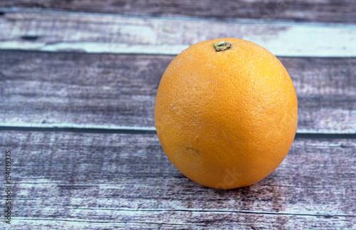 Orange fruit on wooden background. Poster