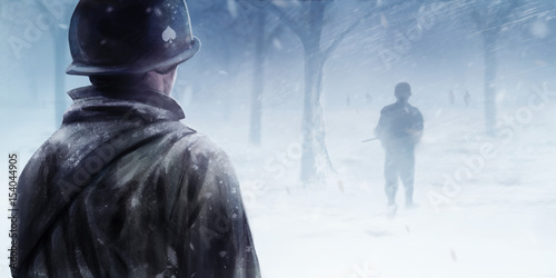 Fotomural WW2 american soldier standing in winter forest and looking at black silhouettes walking forwards in a mist