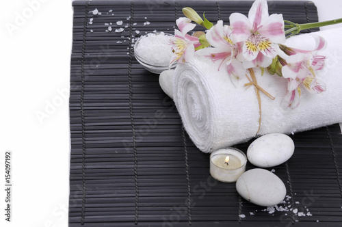 Poster Spa Spa setting with candle, towel ,orchid, ,salt in bowl on mat