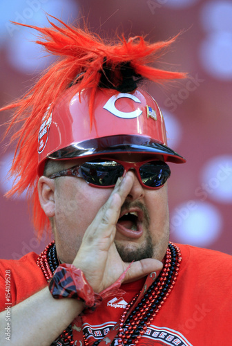 A Cincinnati Reds fan cheers before the Reds play the