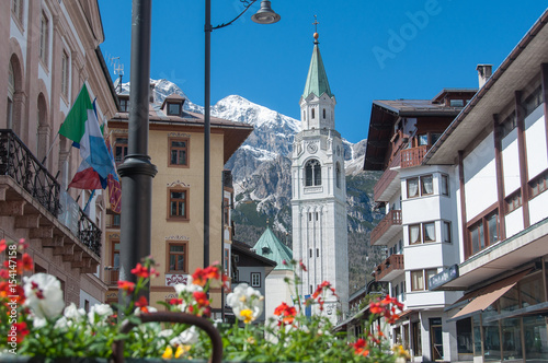 Cortina d'Ampezzo bell tower with flowers in springtime Wallpaper Mural