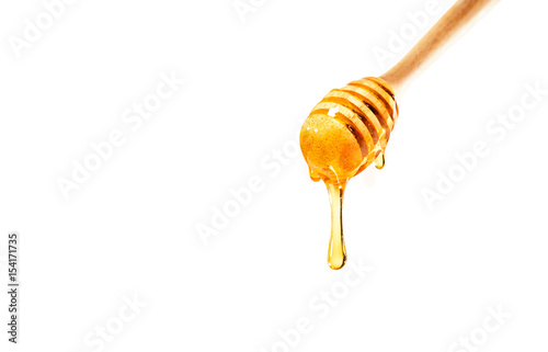 honey on wooden dipper white background Billede på lærred