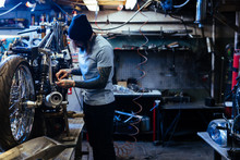 Young Hipster Repairing Custom...