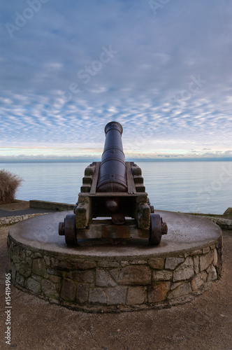 old cannon pointing to sea Poster
