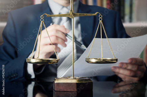 Fotografia, Obraz  Weight scale of justice, lawyer in background