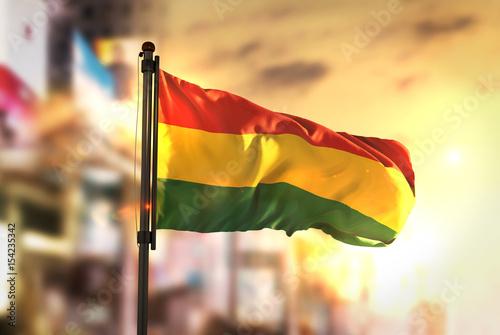 Bolivia Flag Against City Blurred Background At Sunrise Backlight Canvas Print