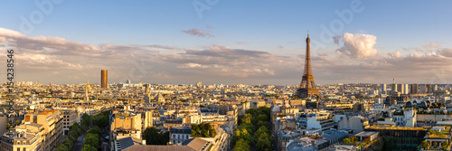 Wall Murals Eiffel Tower Panoramic summer view of Paris rooftops at sunset with the Eiffel Tower. 16th Arrondissement, Paris, France