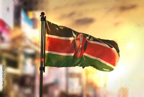 Fotografie, Obraz  Kenya Flag Against City Blurred Background At Sunrise Backlight