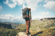 Traveler Man hiking with backpack Travel Lifestyle concept adventure summer vacations outdoor mountains landscape on background
