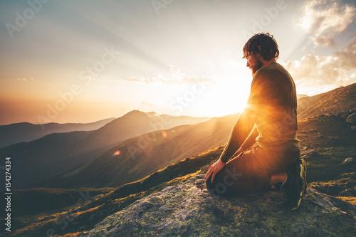 Fotografie, Obraz  Man relaxing at sunset mountains Travel Lifestyle spiritual awakening emotional