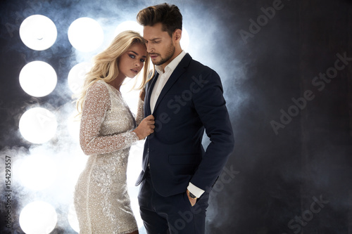 Poster Artist KB Attractive celeb couple posing on the stage