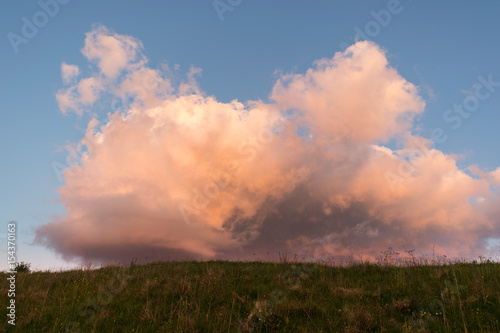 Poster Volcano Red clouds at sunset
