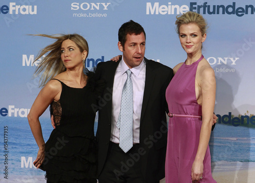 Cast members Aniston, Sandler and Decker pose on the red