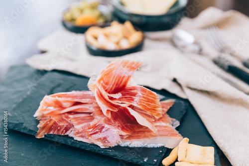 Spanish ham over black booard Canvas Print