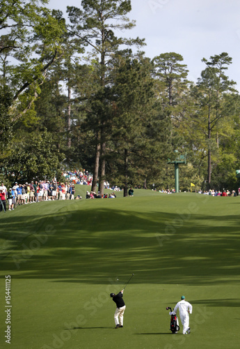 U.S. golfer Phil Mickelson hits a shot on the eighth hole during a ...