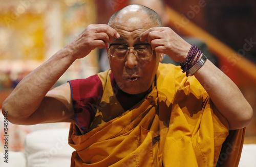 Tibet's exiled spiritual leader the Dalai Lama jokes with