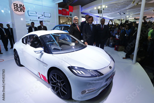 Car Expo Standsay : Automakers race to produce electric cars should jolt oil