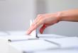 Leinwandbild Motiv Woman casts her ballot at elections