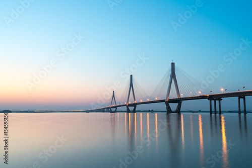 Fotografiet  dongting lake bridge in sunset