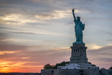 Liberty Statue And Sunset In New York.