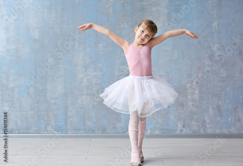 Fotografie, Obraz  Cute little ballerina in dance studio