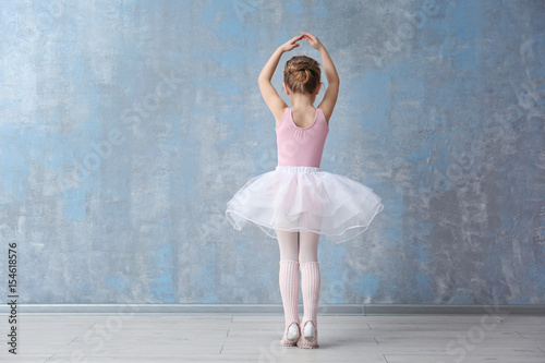 Fototapeta  Cute little ballerina in dance studio