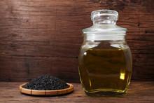 Black Sesame Oil In Glass Jar And Sesame Seeds