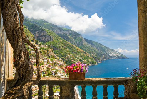 Fototapeta beautiful view of the town of Positano from antique terrace with flowers obraz