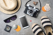 Travel accessories on gray stone background