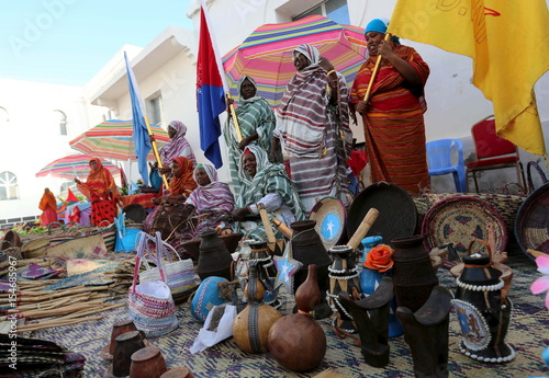 Somali women weave baskets during an event to showcase