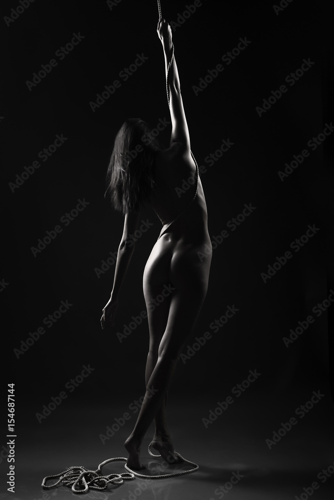 Fototapety, obrazy: silhouette of the naked girl with the rope