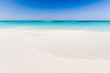 Beautiful tropical beach, white sand and blue sky background with travel yacht boat