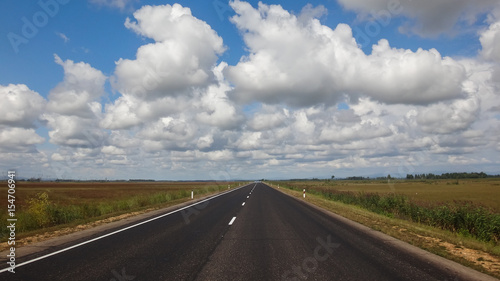 Keuken foto achterwand Route 66 landscape of asphalt road in wild field with mountains at horizon