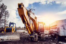 Excavators Machine And Bulldozer Loader In Construction Site On Sky Background. Concept Machines For Construction.