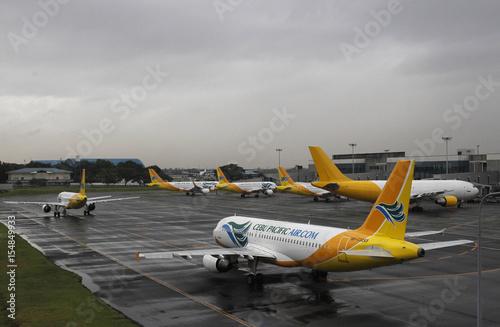 Cebu Pacific airways planes park at the tarmac at Ninoy