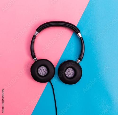 Fényképezés  Headphones on a bright split background
