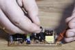 Engineer electronics. Hands close-up.