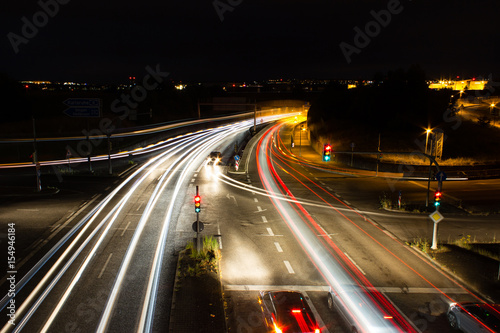 Foto op Aluminium Nacht snelweg Cars in evening street traffic