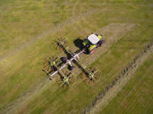 Aerial View Of A Tractor On The Field At The Haymaking In Germany